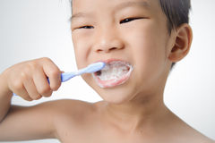 Boy brush his tooth Stock Image