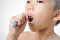 Boy brush his tooth Stock Photography