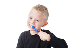 Boy brushes his teeth Stock Photo