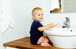 Boy brushes teeth Stock Images