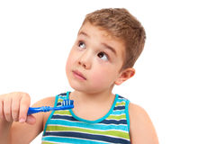 Boy brushing her teeth Royalty Free Stock Photos