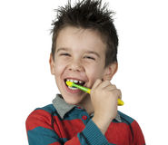 Boy brushing his teeth Stock Photo