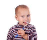 Boy brushing his teeth after bath Stock Photography