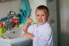 Boy brushing his teeth Stock Photography