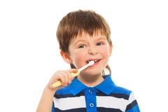Boy brushing his teeth Stock Photos