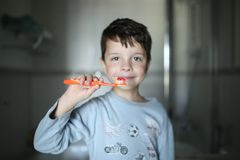 The boy is brushing his teeth stock images
