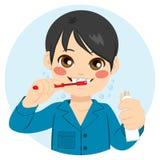 Boy Brushing His Teeth Stock Photo