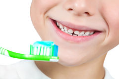 Boy is brushing his teeth. isolated Royalty Free Stock Photography