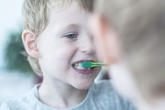 Boy brushing his teeth Royalty Free Stock Photography