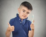 Boy brushing his teeth with toothpaste, manual toothbrush Royalty Free Stock Images