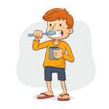 Boy Brushing His Teeth Royalty Free Stock Photo