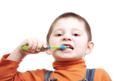 Boy brushing teeth Royalty Free Stock Photos