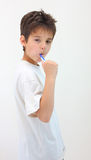 A boy brushing teeth Royalty Free Stock Images