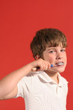 Boy brushing teeth Stock Photography