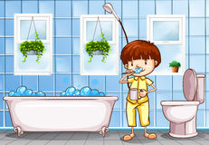 Boy brushing teeth in the bathroom Stock Image