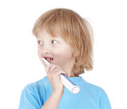 Boy brushing teeth Stock Image