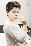 Boy brushing teeth Royalty Free Stock Image
