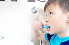 Boy brushing teeth, child dental care, oral hygiene concept, child in bathroom with tooth brush Stock Photo