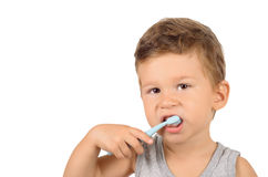 Boy brushing teeth. Cute little boy brushing teeth isolated on white background Stock Images
