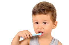 Boy brushing teeth. Cute little boy brushing teeth isolated on white background Stock Photos