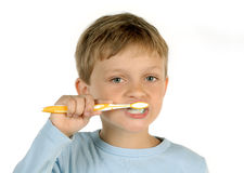 Boy brushing teeth Stock Photo
