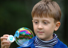The boy and the bubble Royalty Free Stock Photography