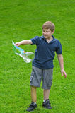 Boy with Bubble Wand Stock Photography