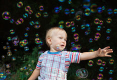 Boy and bubbles Stock Image