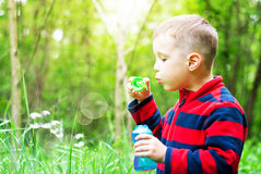 Boy and bubbles Royalty Free Stock Photos