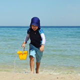 Boy with bucket Royalty Free Stock Images