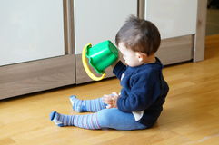Boy and bucket Royalty Free Stock Photography