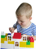 Boy build house. Isolated royalty free stock image