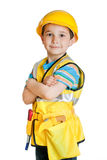 Boy in builder's uniform with tools Royalty Free Stock Image