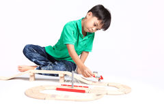 Boy building with colorful wooden blocks Royalty Free Stock Photos