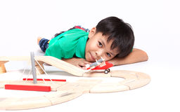 Boy building with colorful wooden blocks Stock Photo