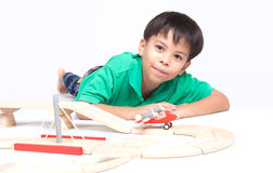Boy building with colorful wooden blocks Stock Image