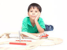 Boy building with colorful wooden blocks Stock Photography