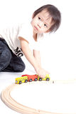 Boy building with colorful wooden blocks Royalty Free Stock Image