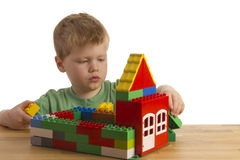Boy is building a house. With blocks Stock Photos