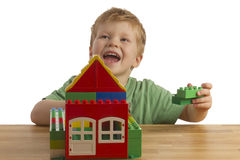 Boy is building a house Royalty Free Stock Image