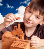 Boy building house. Isolated on white Stock Images