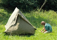 Boy building an old tent Stock Images