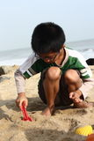 Boy Building Sand Castle Royalty Free Stock Photos