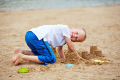 Boy building sand castle in summer Royalty Free Stock Image