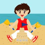 Boy Building Sandcastle Stock Images