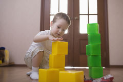 Boy Building Towers From Colorful Cubes Royalty Free Stock Photos