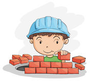 Boy building wall Royalty Free Stock Image