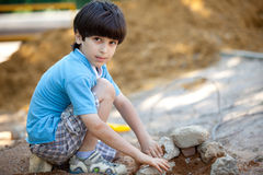 Boy builds a house Stock Images