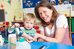 Boy Builds Junk Model In Pre School Class royalty free stock image