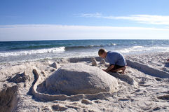 Boy Builds Sand Castle Royalty Free Stock Image